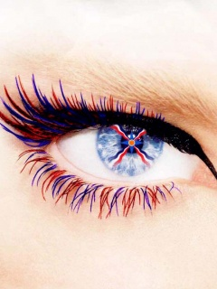 Assyrian flag in the eye of a girl with red and blue eyelashes