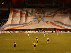 Assyrian flag, very large held with fans of Assyrian football team in Sweden